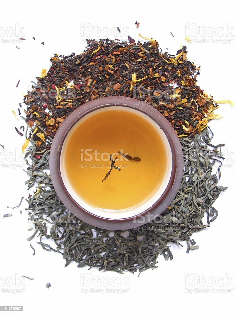 Tea leaves with cup royalty-free stock photo