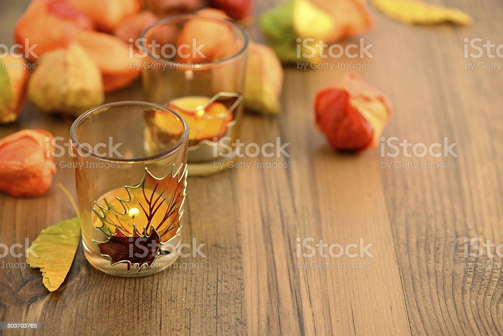 Tea light and bladder cherry decoration stock photo