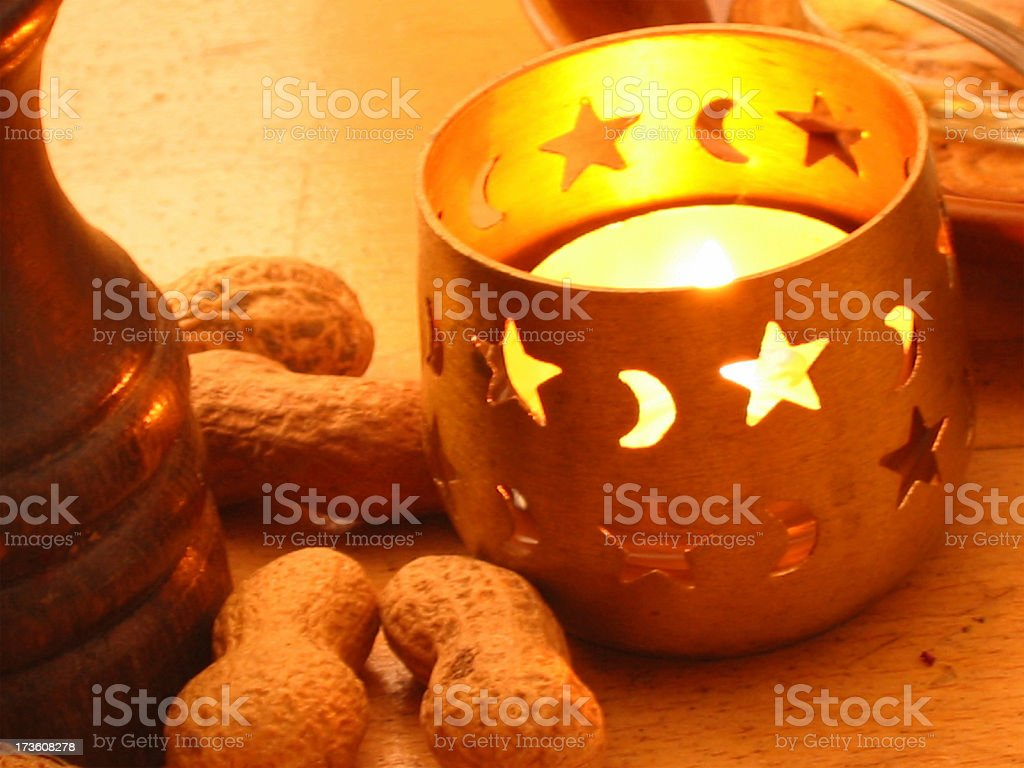 Tea light and peanuts royalty-free stock photo