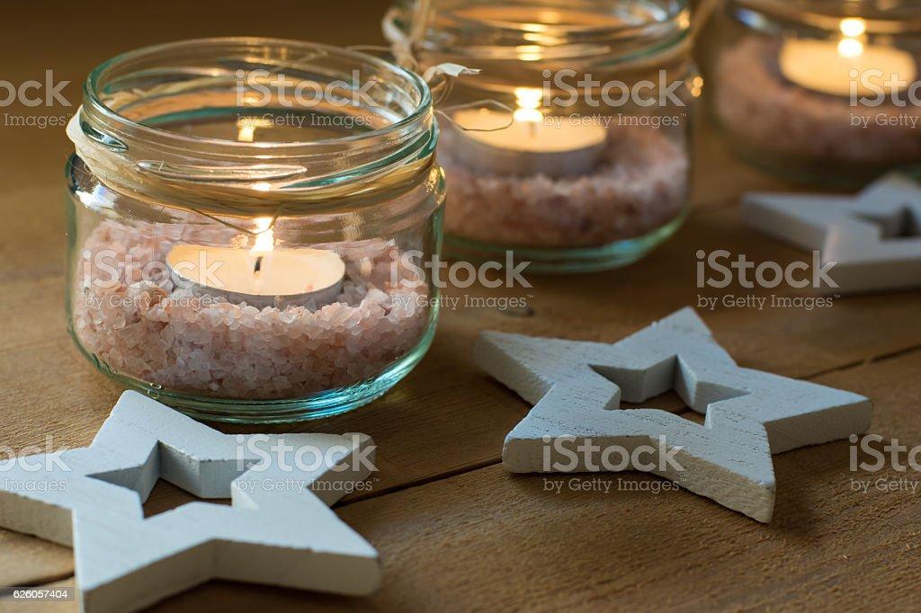 Tea lights in jars with salt, Christmas, New Year, advent stock photo