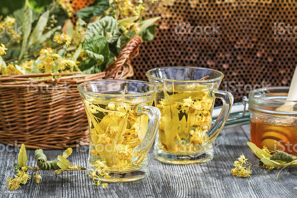 Tea made of lime and honey served in the garden royalty-free stock photo