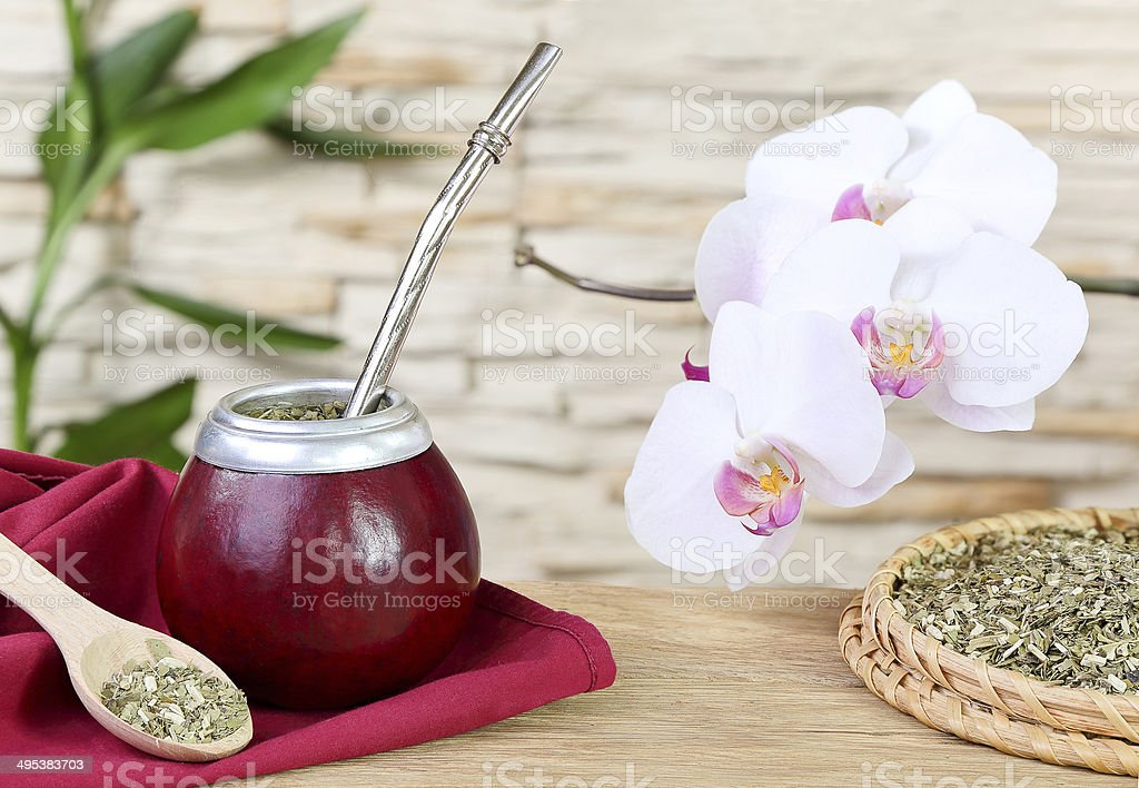 Tea mate in the calabash and orchid stock photo