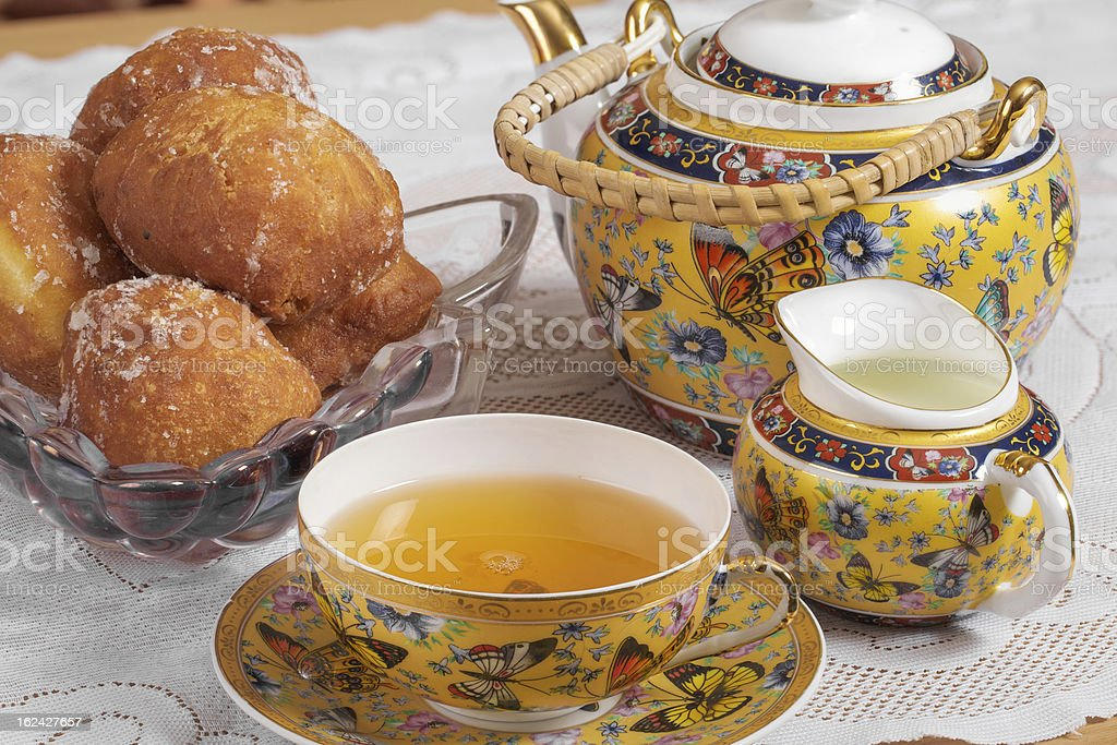Tea, milk and donuts stock photo