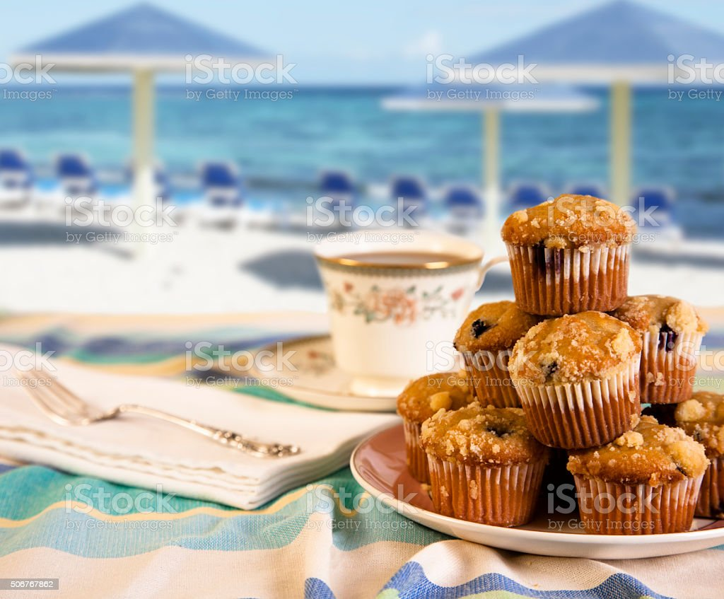 Tea, muffins on beach background.  Breakfast. Relaxation. stock photo