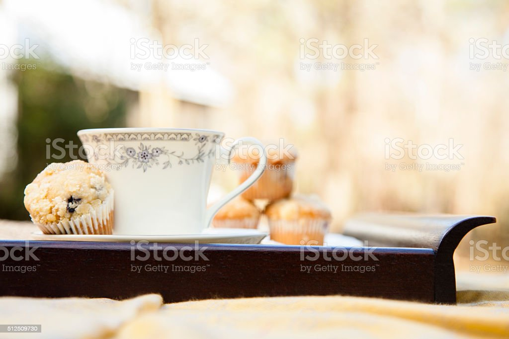 Tea, muffins with house background.  Breakfast. Relaxation. stock photo