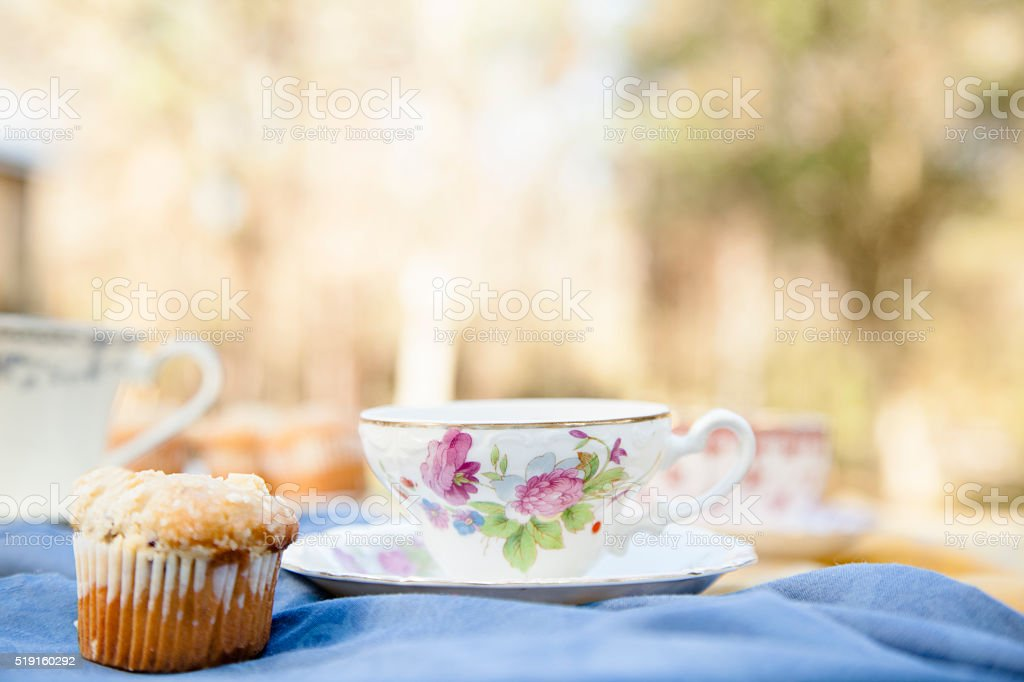 Tea, muffins with house, yard background.  Breakfast. Relaxation. stock photo
