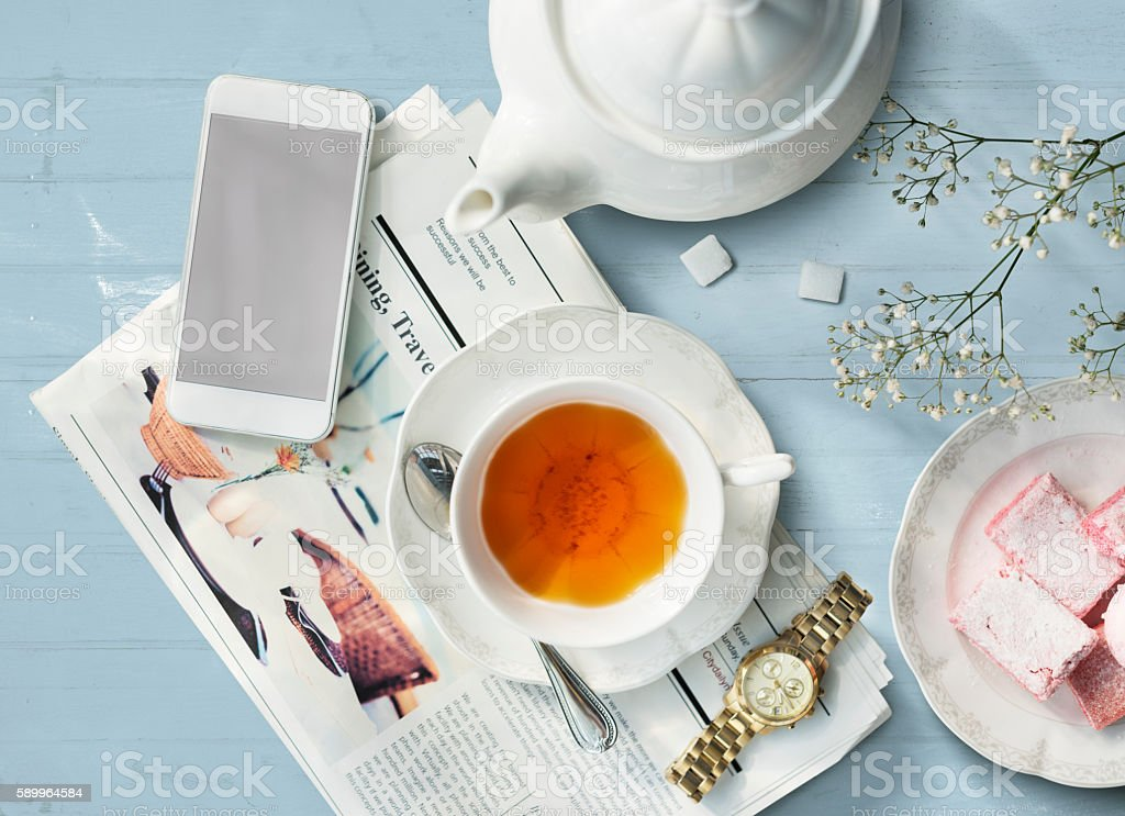 Tea Newspaper Watch Information Simple Relax Concept stock photo