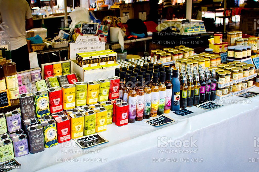 Tea, olive oil and other foodstuffs on a market stall stock photo