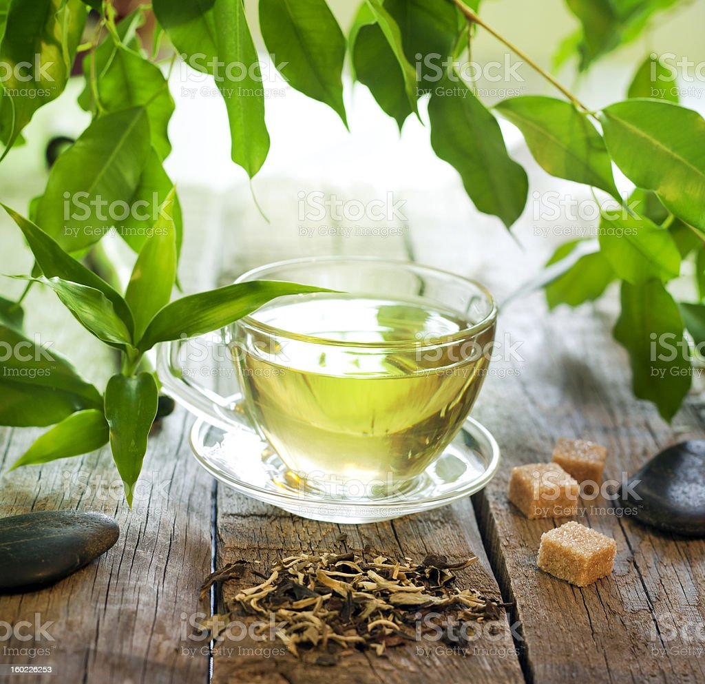 Tea on wooden boards with green leaves royalty-free stock photo