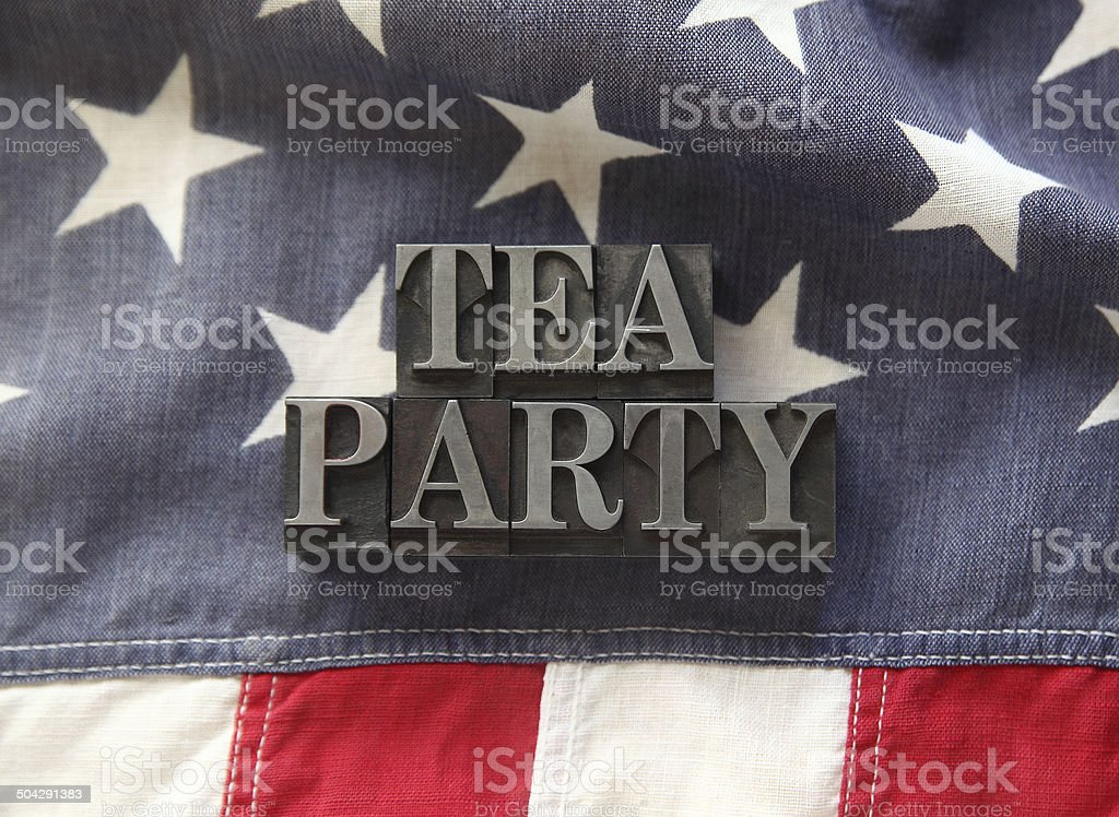 tea party in metal type on American flag stock photo
