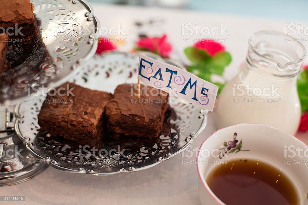 Tea Party Table Setting with Cakes and Tea stock photo