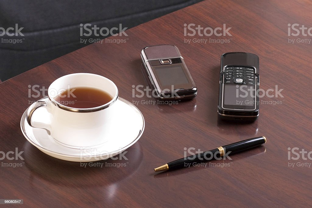 tea, pen and two cellulars stock photo