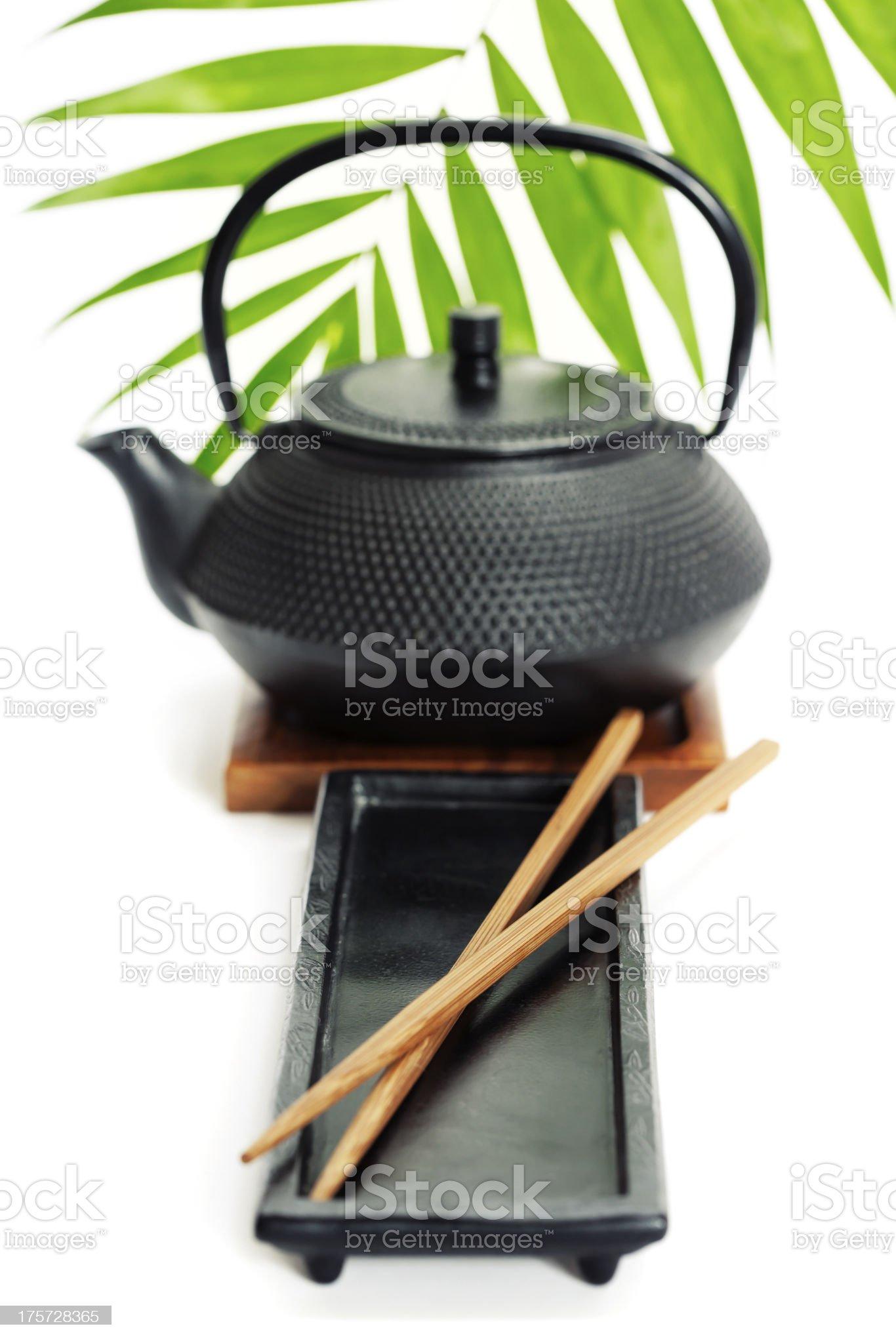 Tea pot and chopsticks royalty-free stock photo