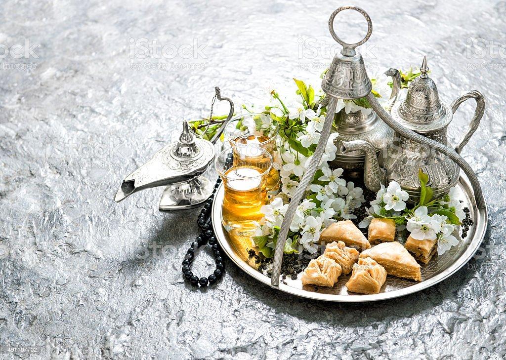 Tea pot and glasses, sweets. Islamic holidays. Hari Raya Aidilfitri stock photo