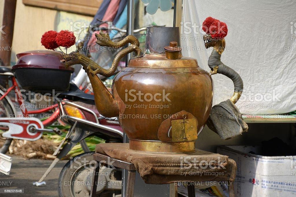 Tea pot outside restaurant in Hohhot Muslim Quarter, Inner Mongolia stock photo