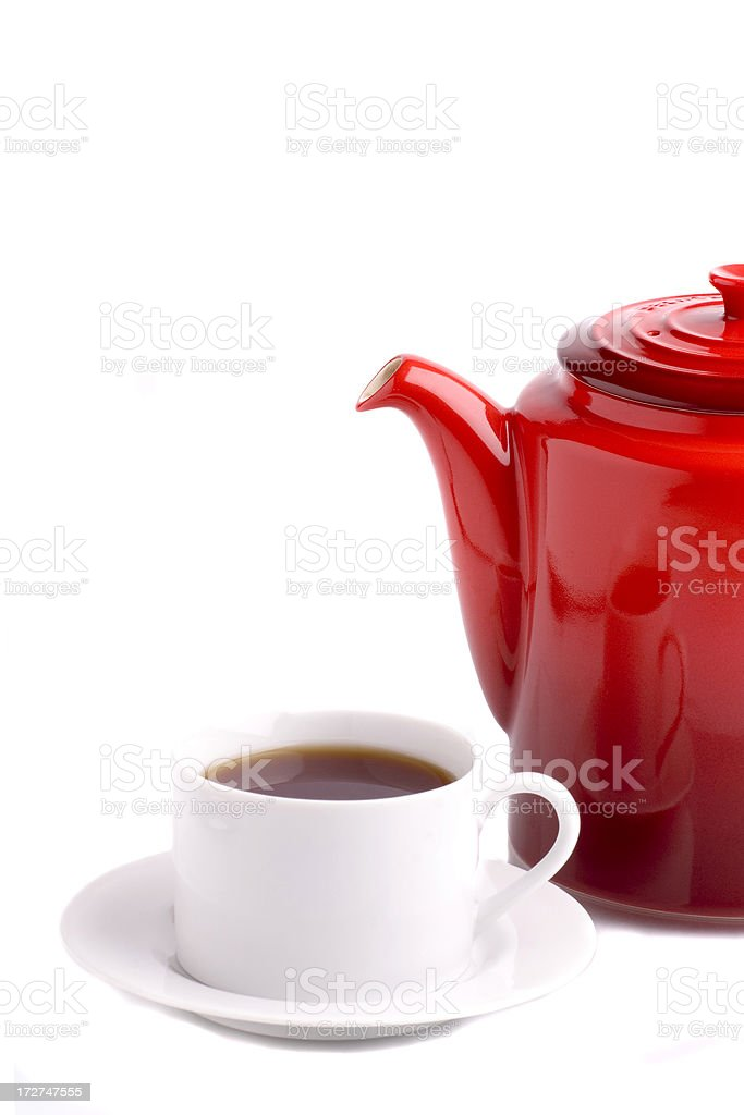 Tea pot with cup and saucer stock photo