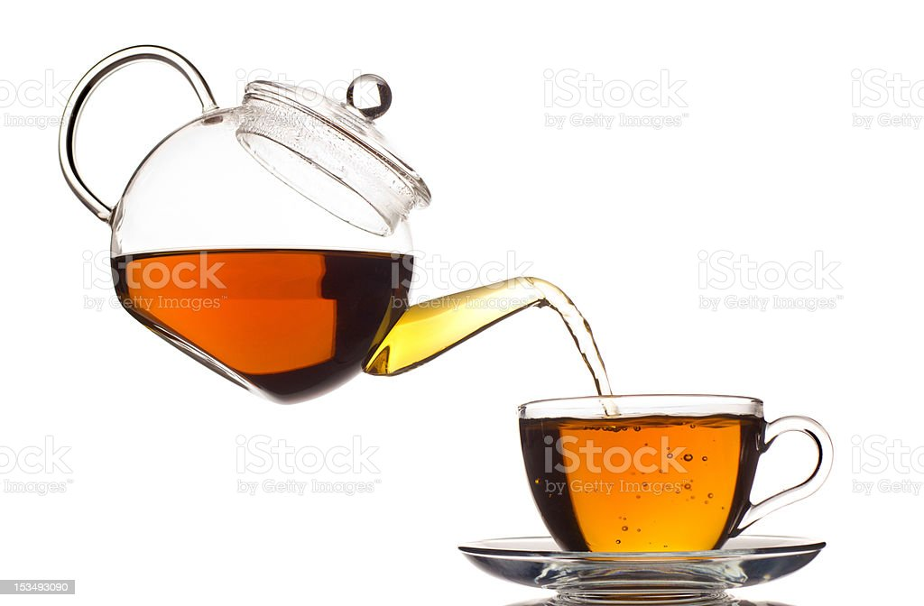 tea pouring in the cup stock photo