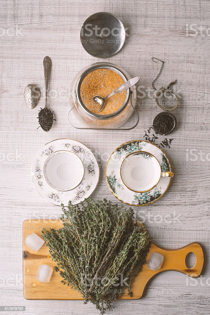 Tea preparation set with herbs vertical stock photo