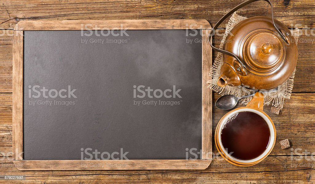 Tea set and  chalkboard, above view. stock photo