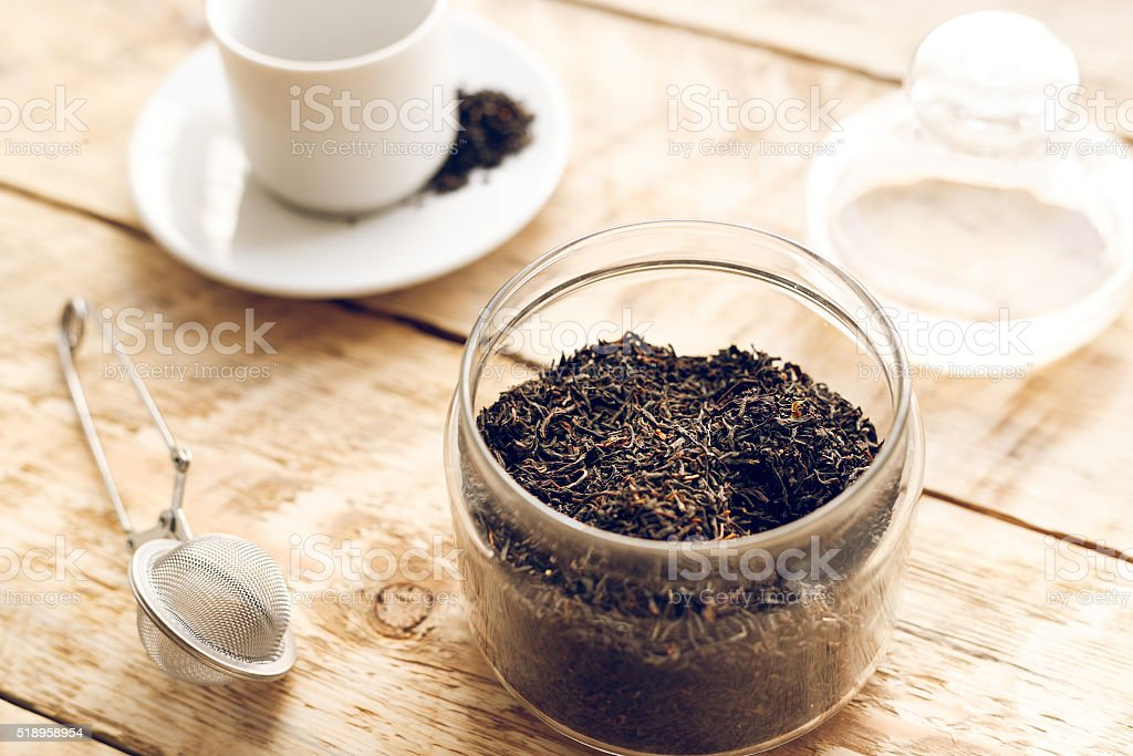 Tea set on the wooden table at sunny morning stock photo