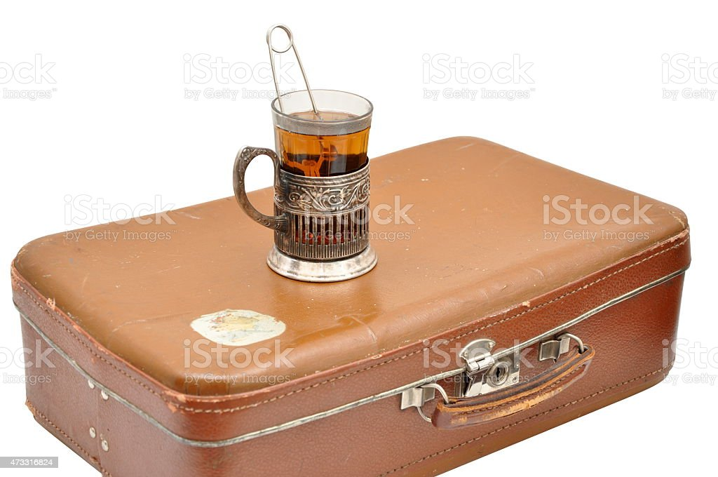 Tea set with glass-holder and old suitcase isolated stock photo