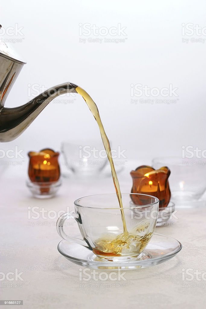 Tea starting to fill teacup royalty-free stock photo