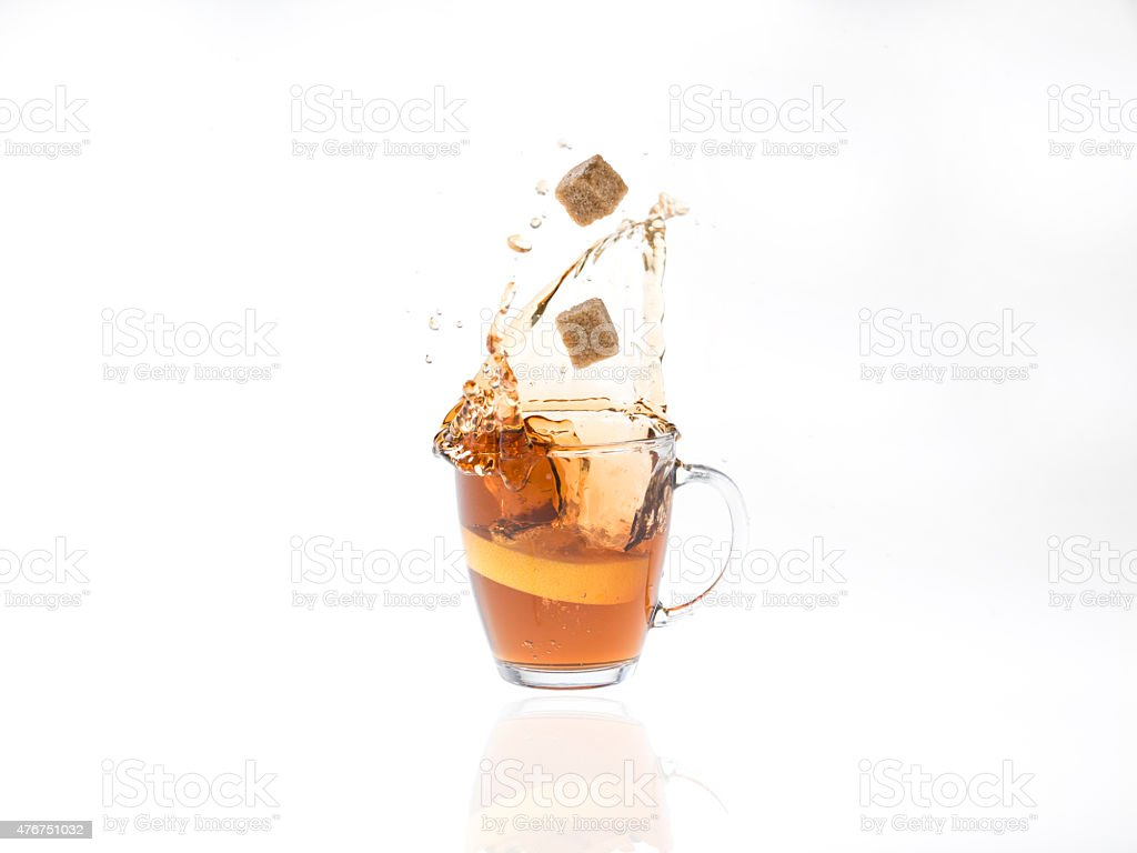 Tea  storm with slice of lemon and sugar cubes stock photo