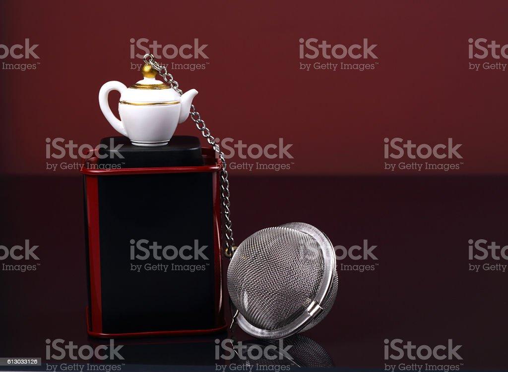Tea strainer, box of tea stock photo