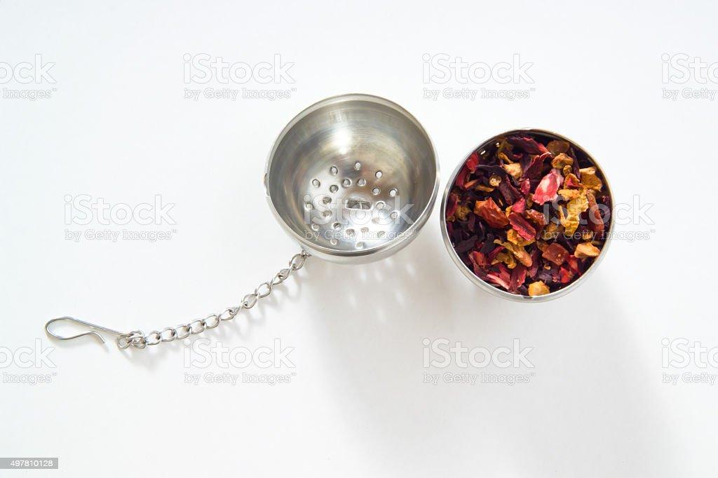 Tea strainer, fruit tea, white background stock photo