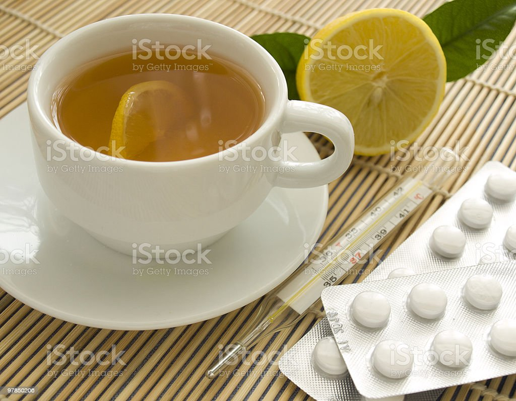 Tea, thermometer and pills stock photo