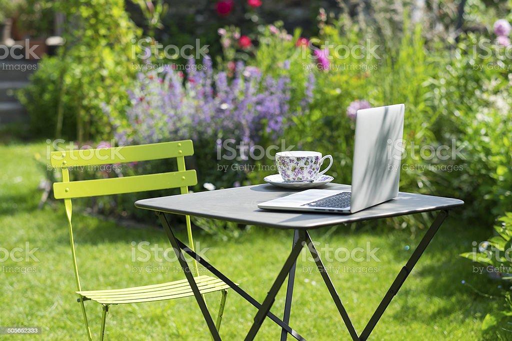 Tea time in a garden stock photo