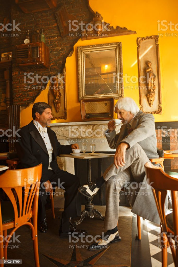 Tea time  Two active senior man  drinking tea  Retro friends stock photo