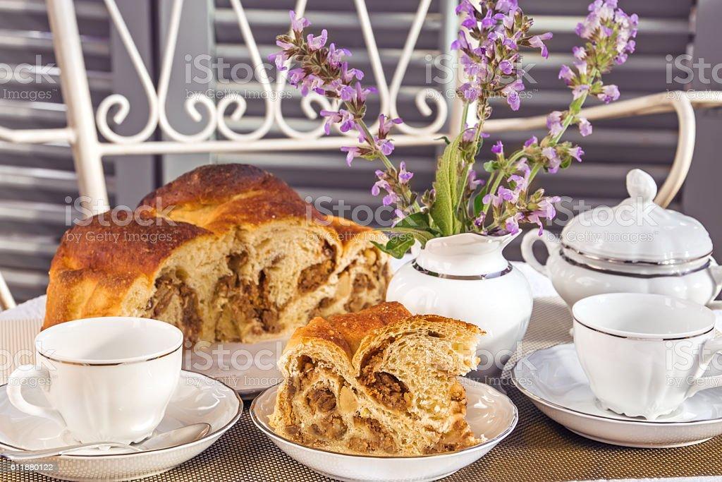Tea time with typical italian flavorous farmhouse cake La Gubana. stock photo