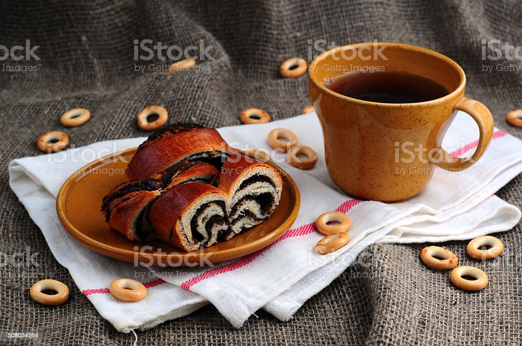 Tea with a roll stock photo