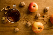 tea with apples and nuts on wooden table