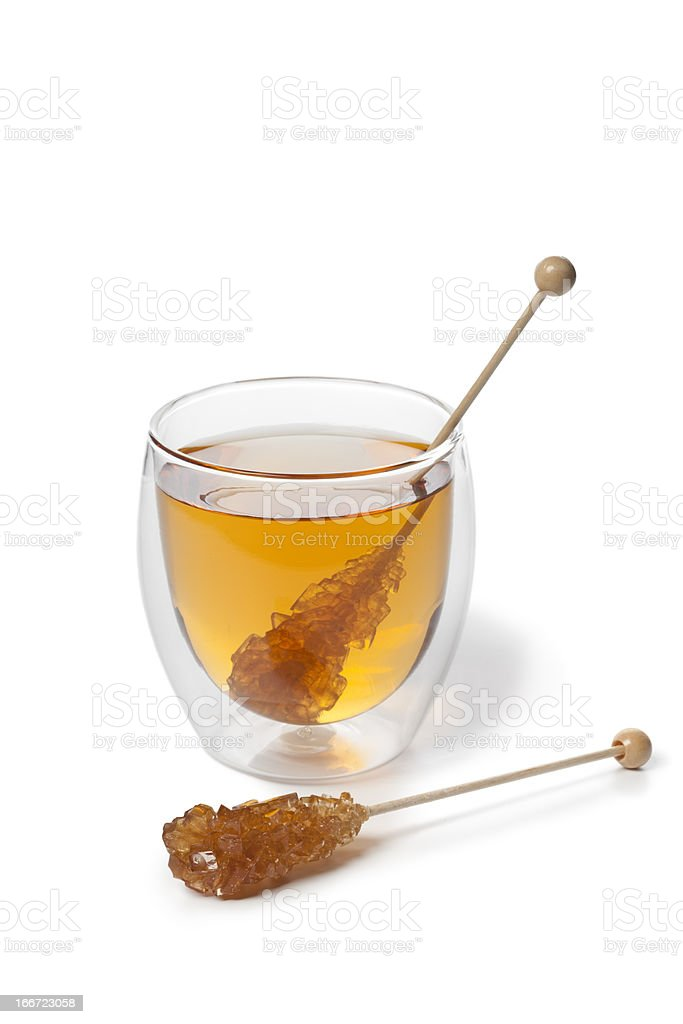 Tea with brown Rock candy stick royalty-free stock photo