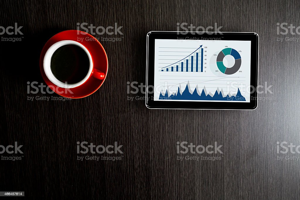 Tea with business graph on digital tablet stock photo