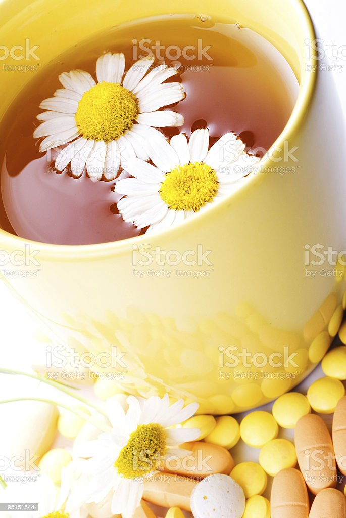 Tea with Chamomile and pills stock photo