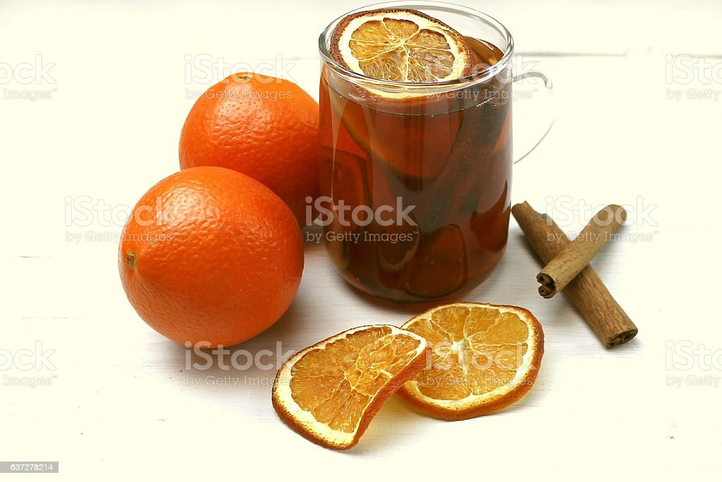 Tea with dried fruits, citrus and cinnamon stock photo