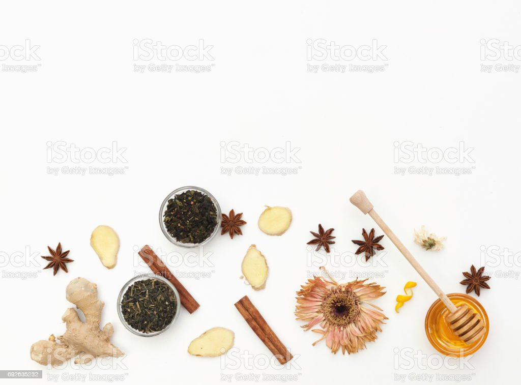 Tea with ginger and honey over white background. Flat lay composition stock photo
