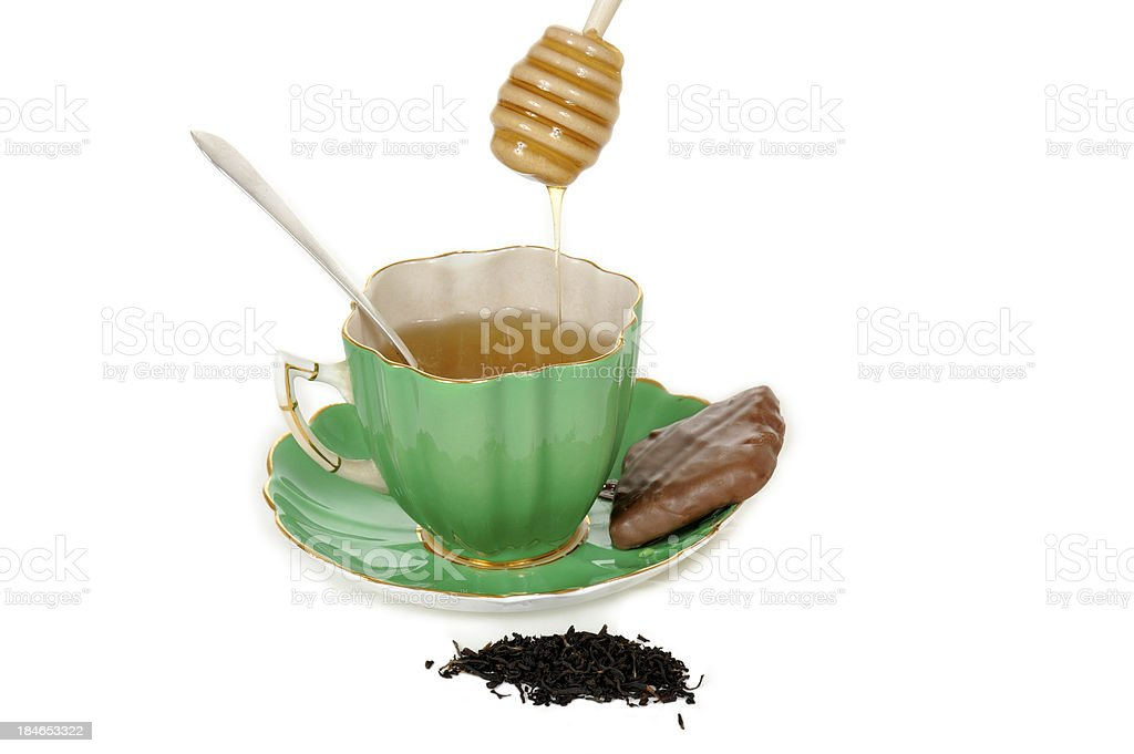Tea with Honey and Chocolate Biscuit royalty-free stock photo