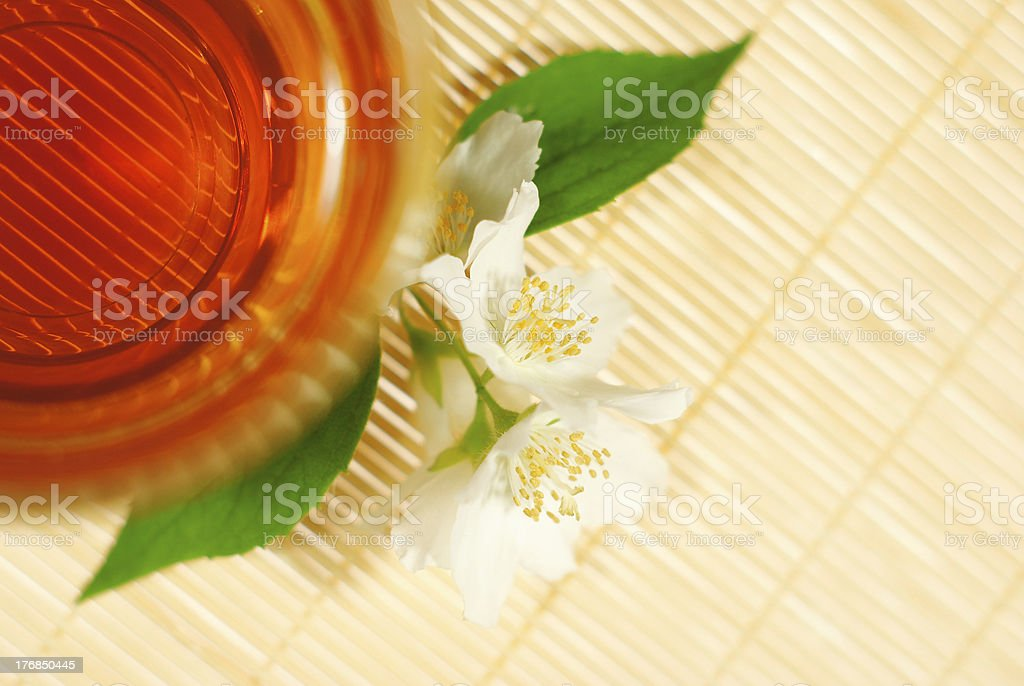 Tea with jasmine flowers and leaves, directly above royalty-free stock photo
