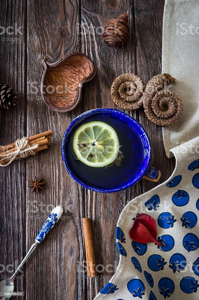 Tea with lemon and aromatic spices stock photo