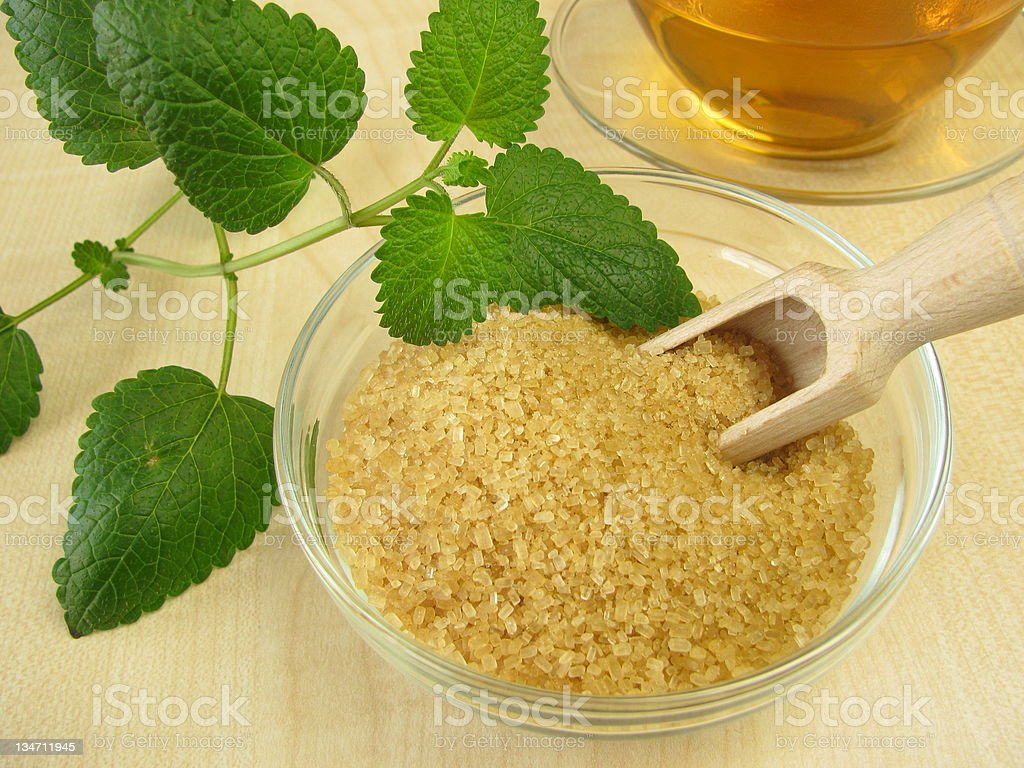 Tea with lemon balm and raw cane sugar royalty-free stock photo