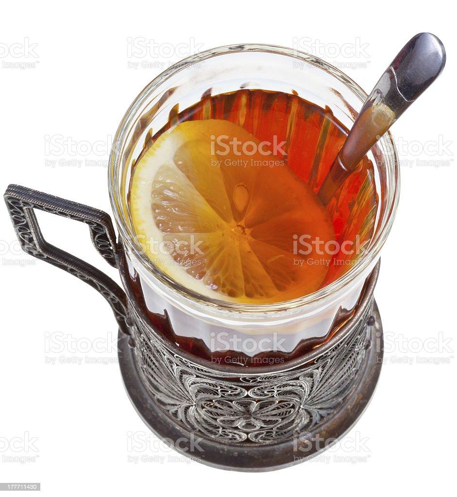 tea with lemon in vintage glass stock photo