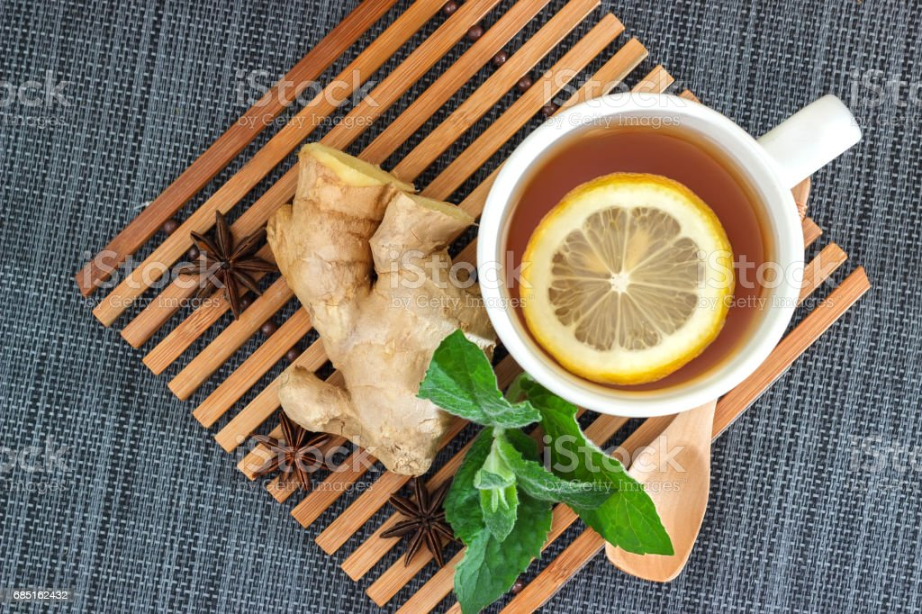 Tea with lemon leaves mint, root ginger and anise stock photo