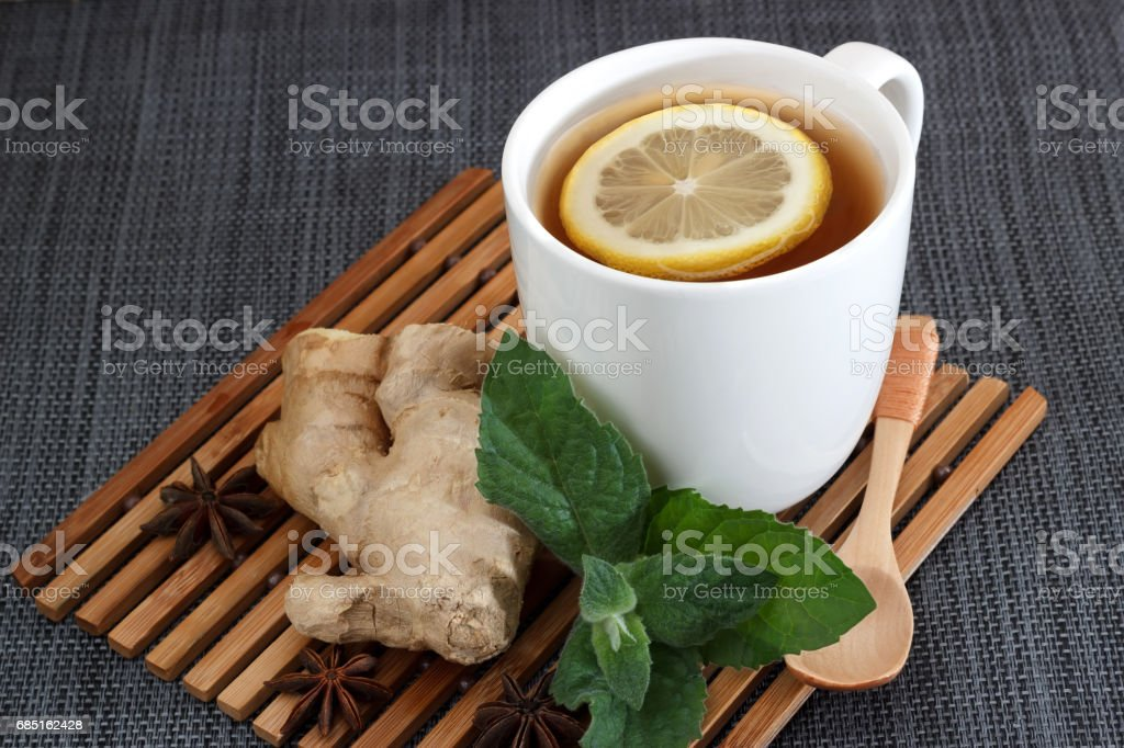 Tea with lemon leaves mint, root ginger and anise. . View from above stock photo