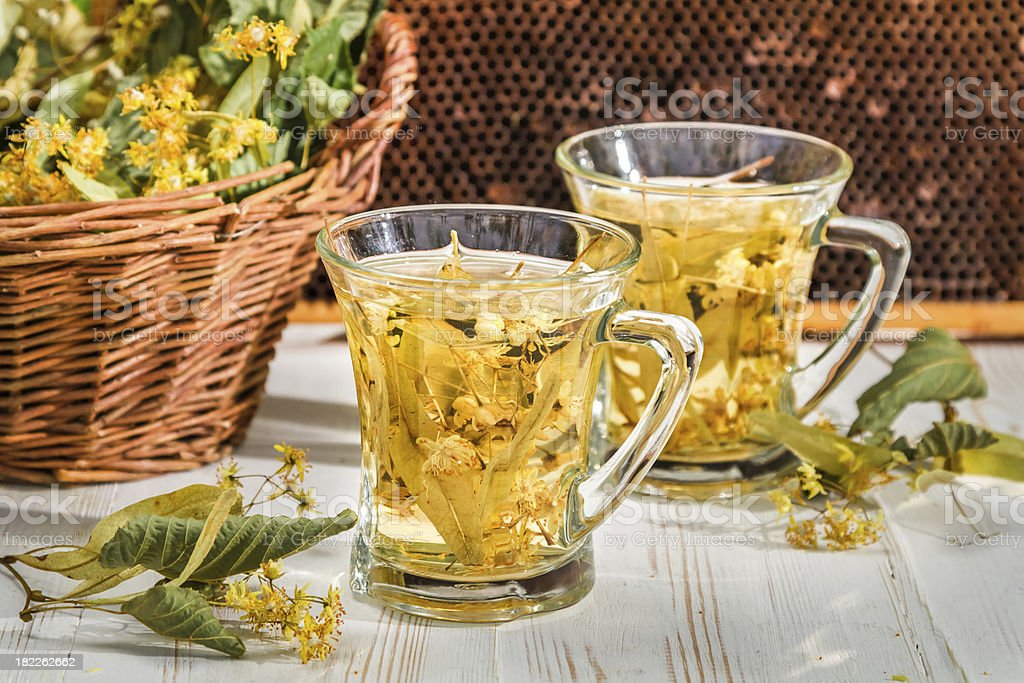 Tea with lime and honey in the garden at summer royalty-free stock photo