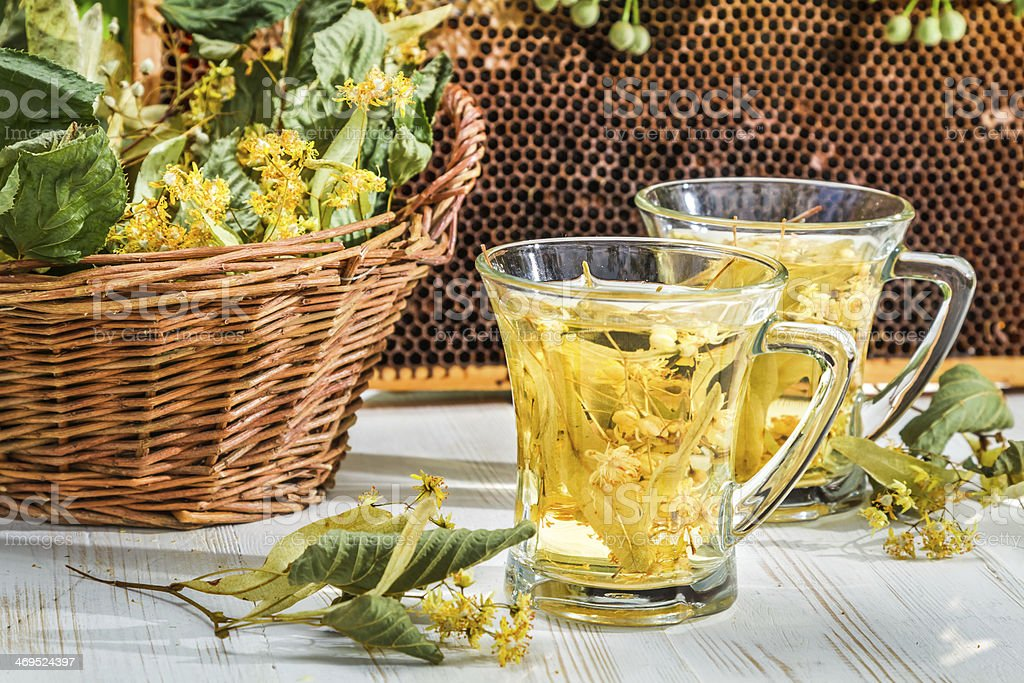 Tea with lime, honey served in the garden at summer royalty-free stock photo