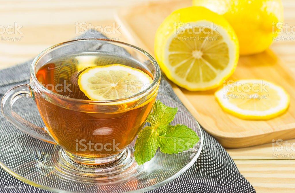 tea with mint  and lemon on wood background,warm toning stock photo